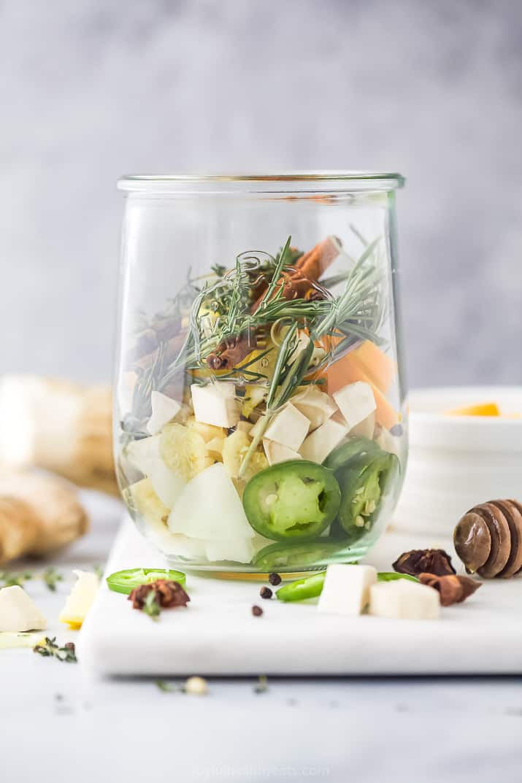 fire cider ingredients in a mason jar