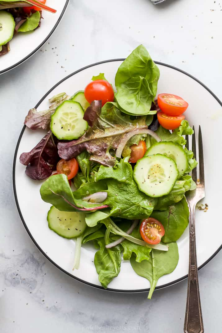 a plate with a simple side salad