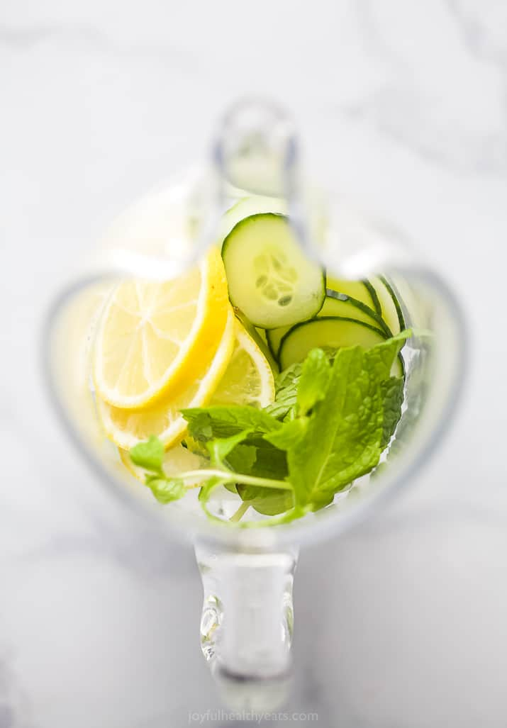 a pitcher filled with cucumber lemon and mint