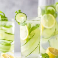 glass filled with lemon water and cucumbers
