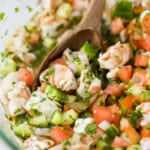A Close-Up Image of Ceviche Being Gently Stirred with a Spoon