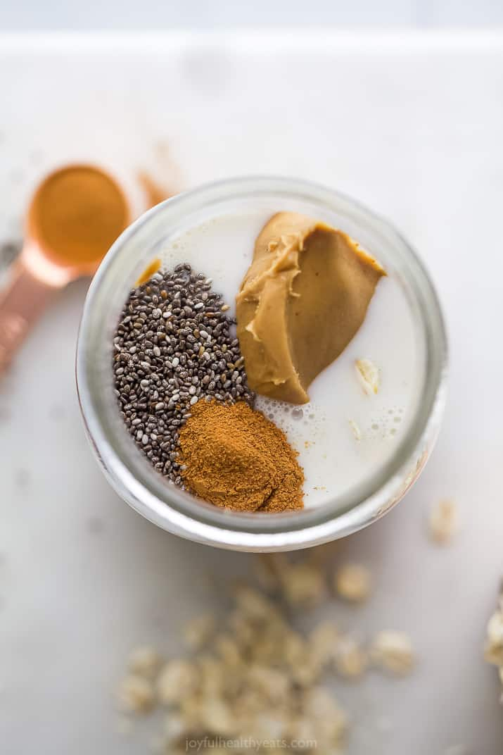 overhead photo of a jar with peanut butter, chia and cinnamon