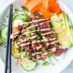 A Tuna Poke Bowl with a Pair of Black Chopsticks Balanced on the Bowl