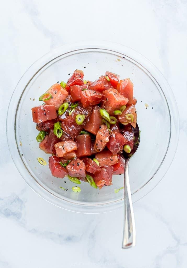 Chunks of Bluefin Tuna Marinating in a Glass Bowl