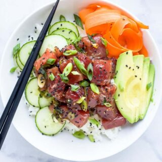 A Hawaiian Poke Bowl Sitting on Top of a Black and White Marble Counter
