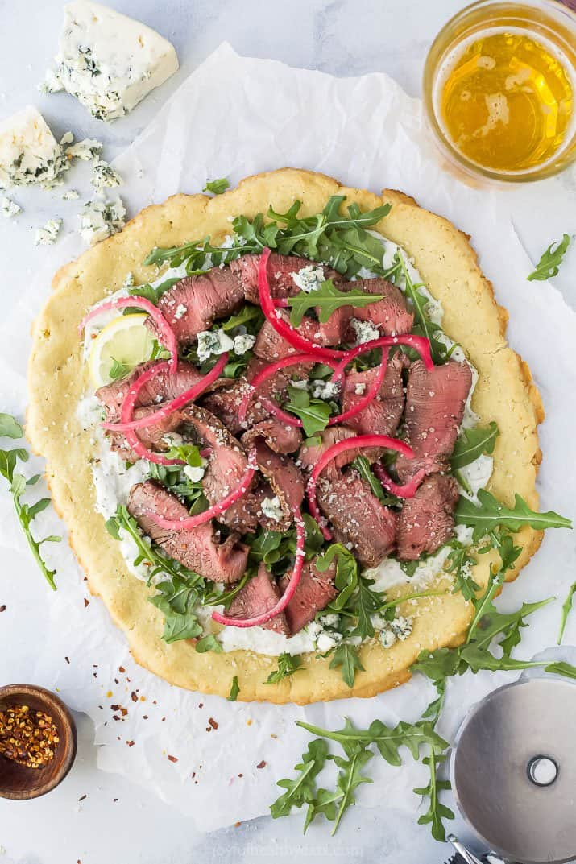 gluten free flatbread topped with steak
