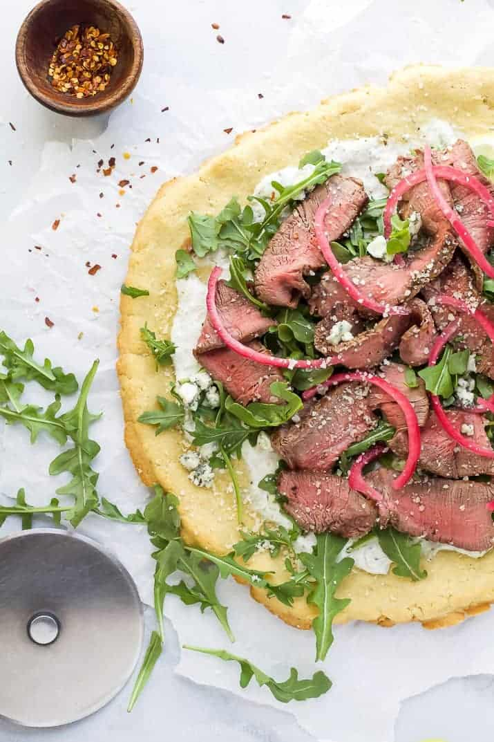 flatbread pizza with steak and arugula
