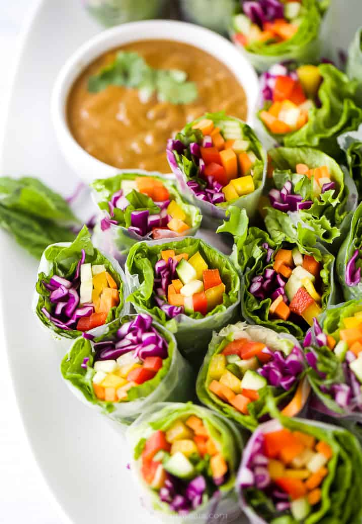 A Close-Up Shot of Summer Veggie Rolls with a Bowl of Peanut Sauce in the Background