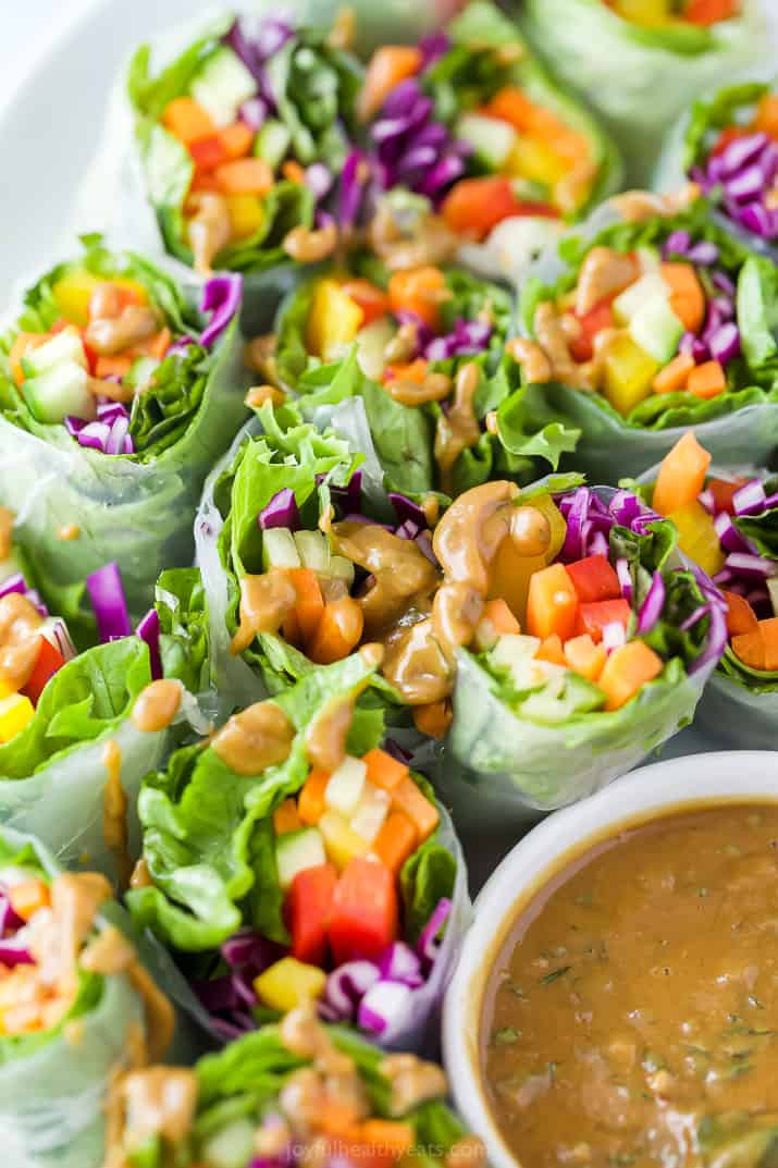 A Plate of Summer Vegetable Rolls with a Little Bit of Peanut Sauce Drizzled Over Them