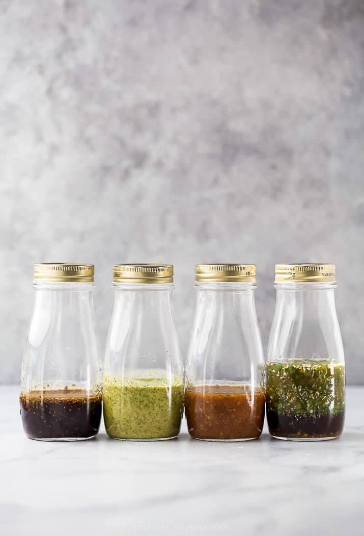 jars filled with homemade salad dressing