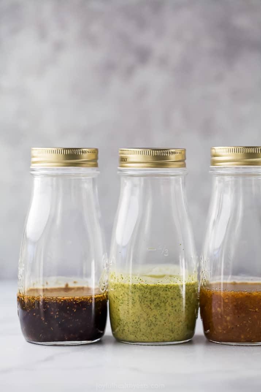 jars with healthy salad dressings