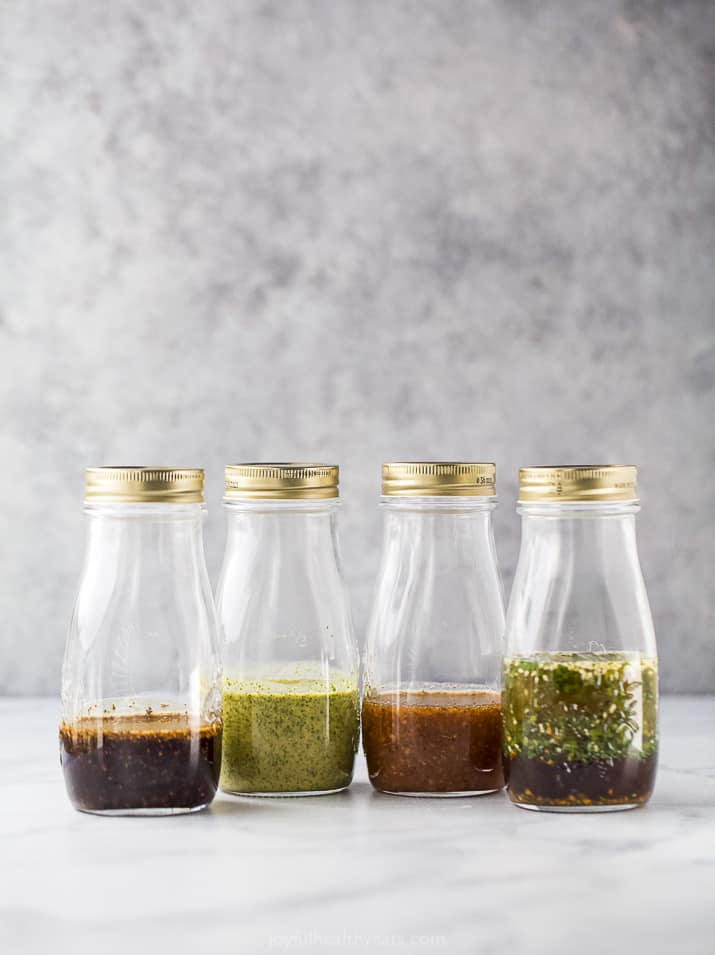 jars filled with homemade salad dressings