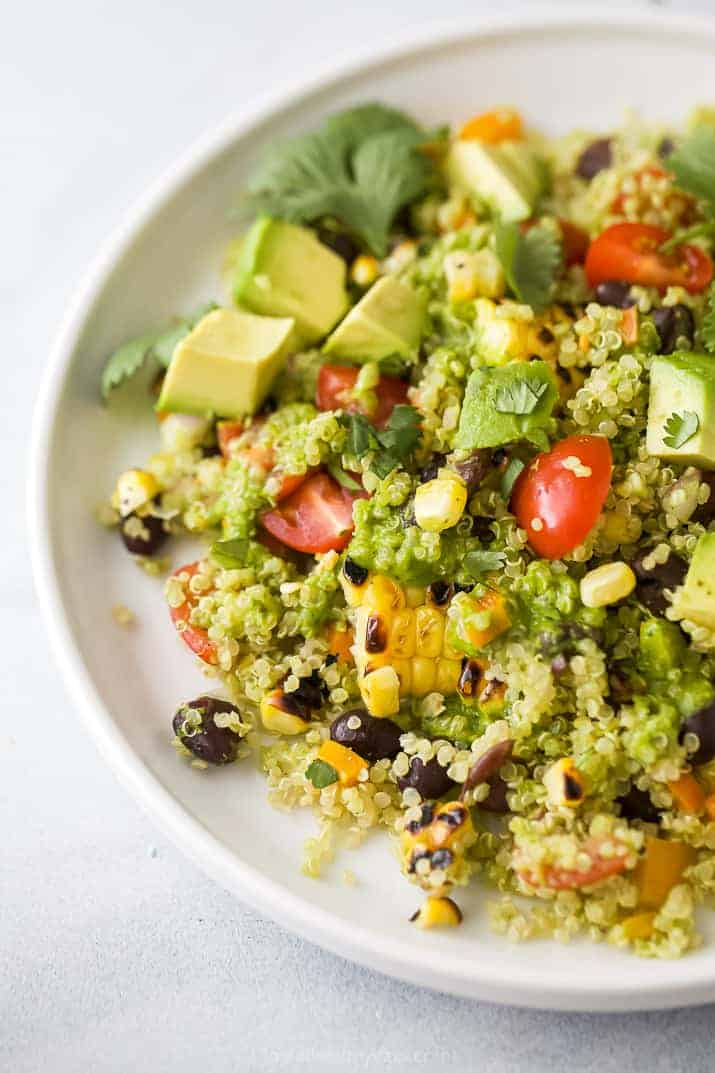 Close-up of a serving of fiesta quinoa topped with avocado pieces