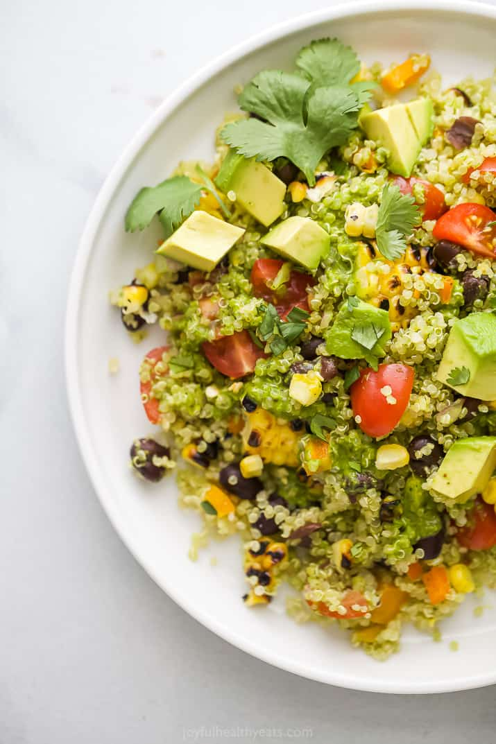 A plate of mexican quinoa salad topped with cilantro.