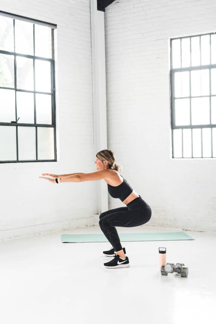 girl performing a squat exercise