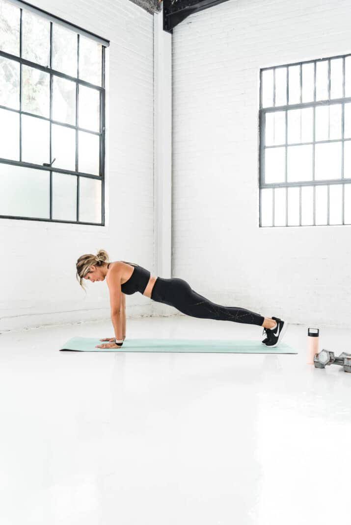 girl in workout clothes performing a plank