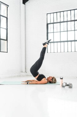 girl in workout clothes performing a reverse situp