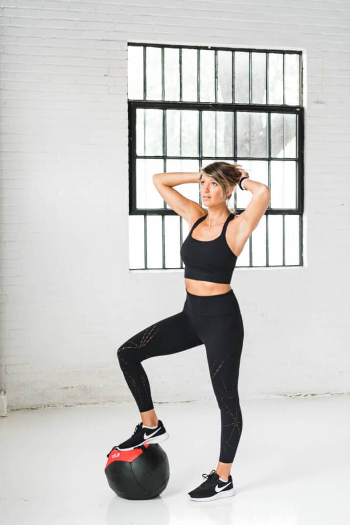 girl in workout clothes with wall ball