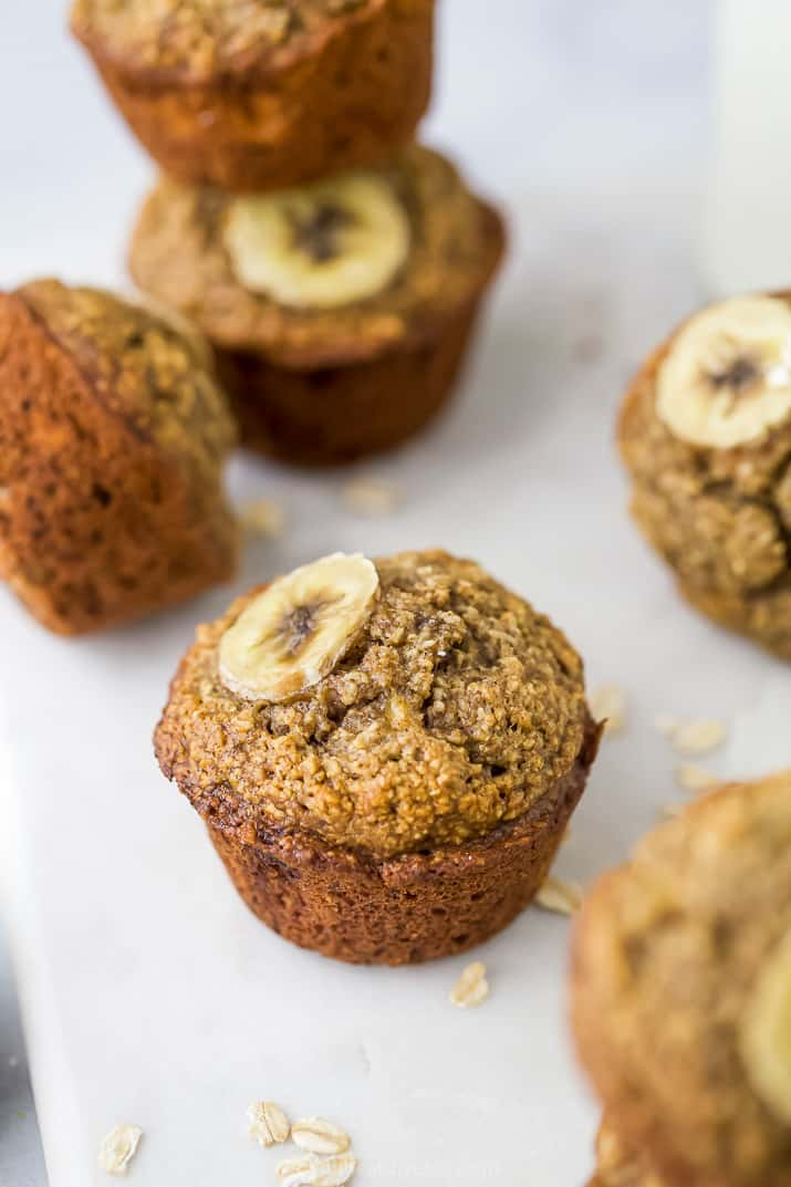 Maple Banana Oat Muffins topped with a slice of banana