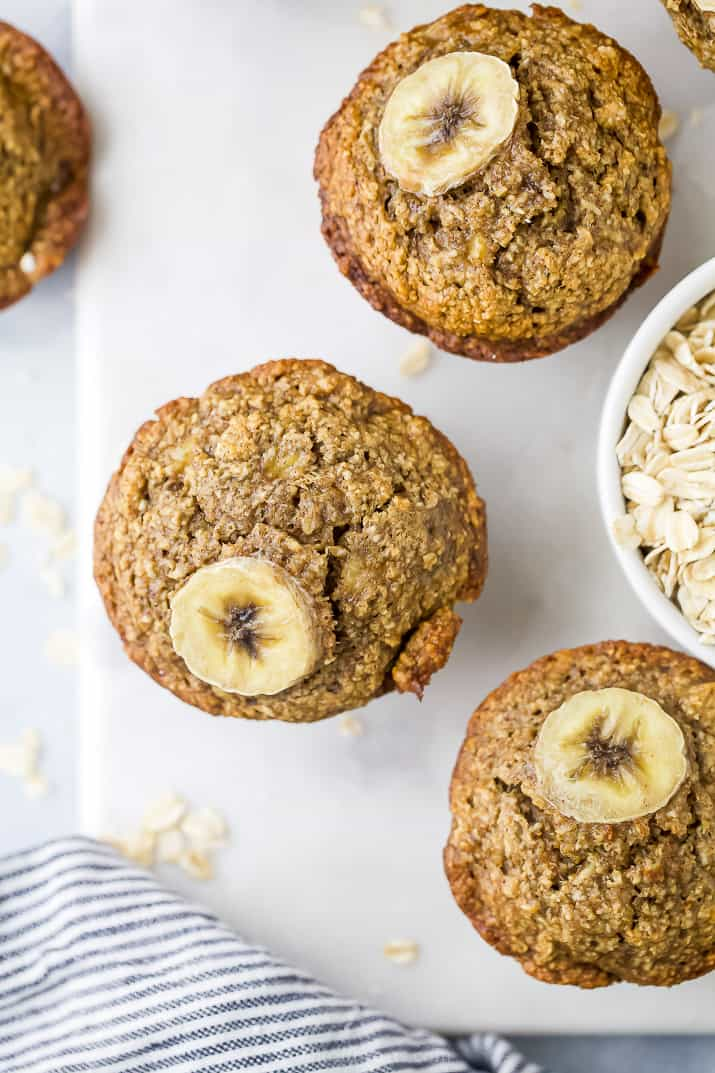 Aerial view of muffins topped with a slice of banana