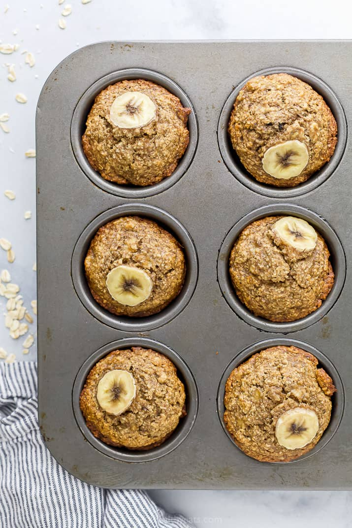 Maple banana oat muffins in a muffin pan
