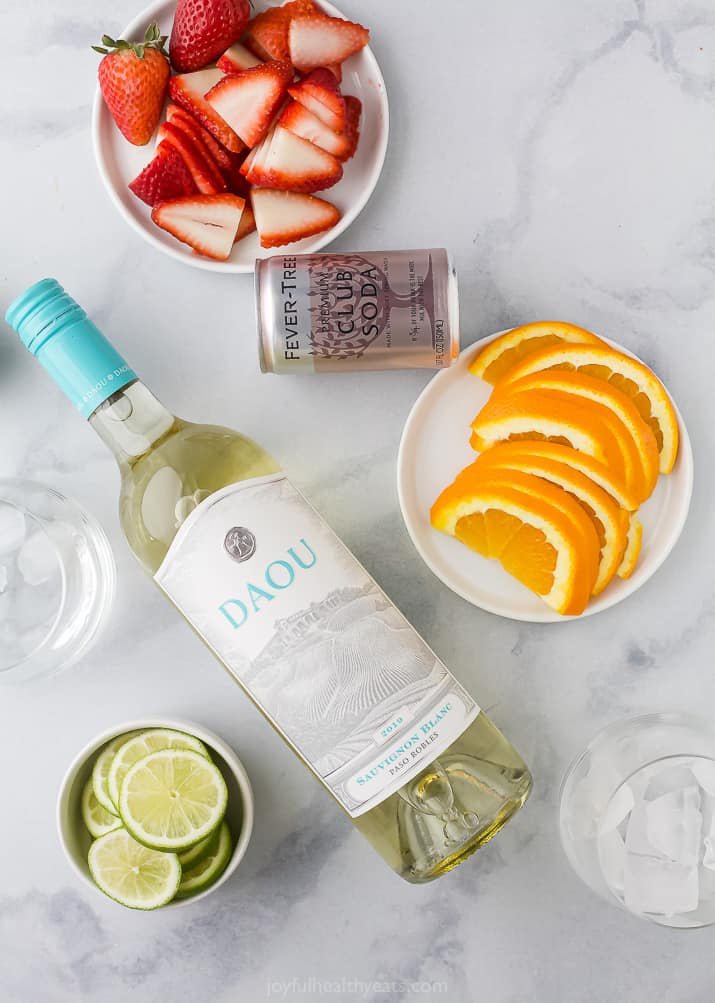 The ingredients needed for strawberry citrus white wine spritzer