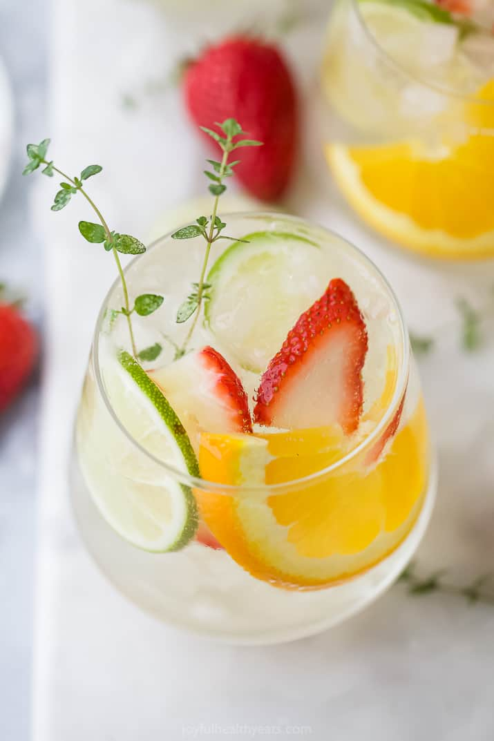 A glass of refreshing citrus white wine spritzer