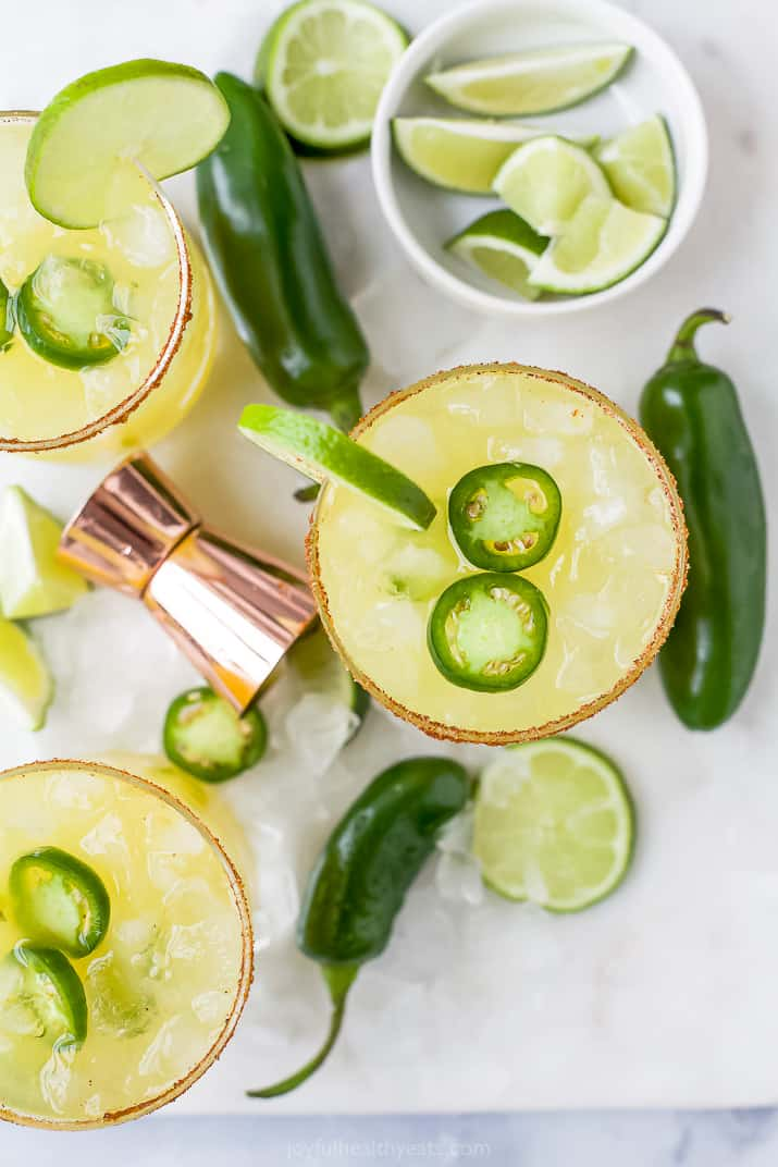 glasses filled with spicy margarita mixture and jalapenos
