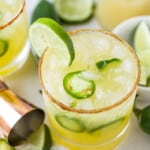 glass with spicy margaritas with jalapenos and lime