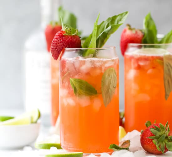 Two glasses with strawberries and vodka