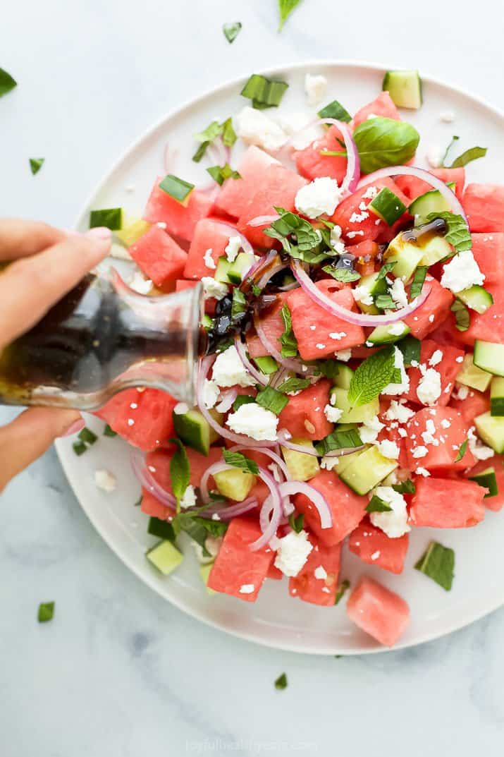 balsamic dressing poured on top of watermelon feta salad