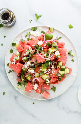plate filled with watermelon feta salad with cucumber