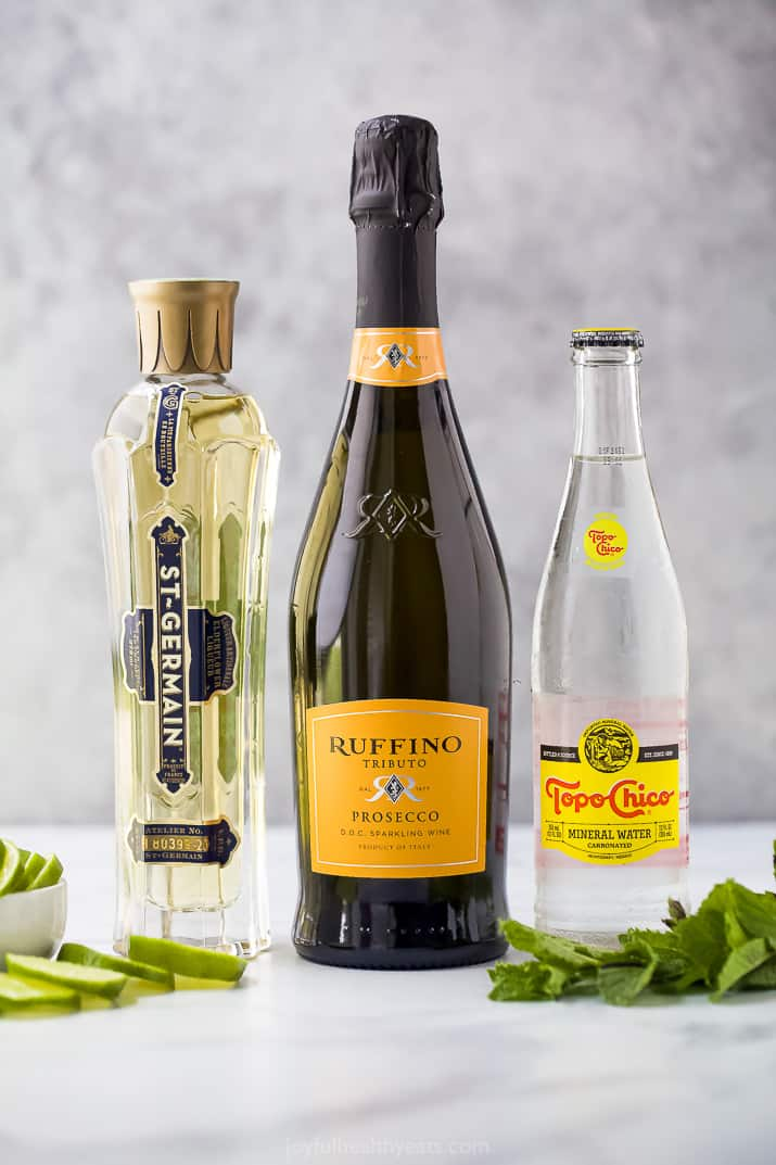 Bottles of St. Germain, Prosecco and mineral water
