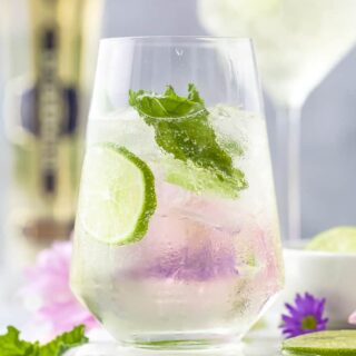 Hugo Cocktail with lime and mint in a large wine glass