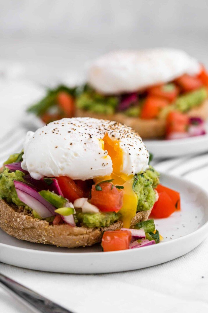 Two Servings of Eggs Benedict with Pico on Two Separate Plates