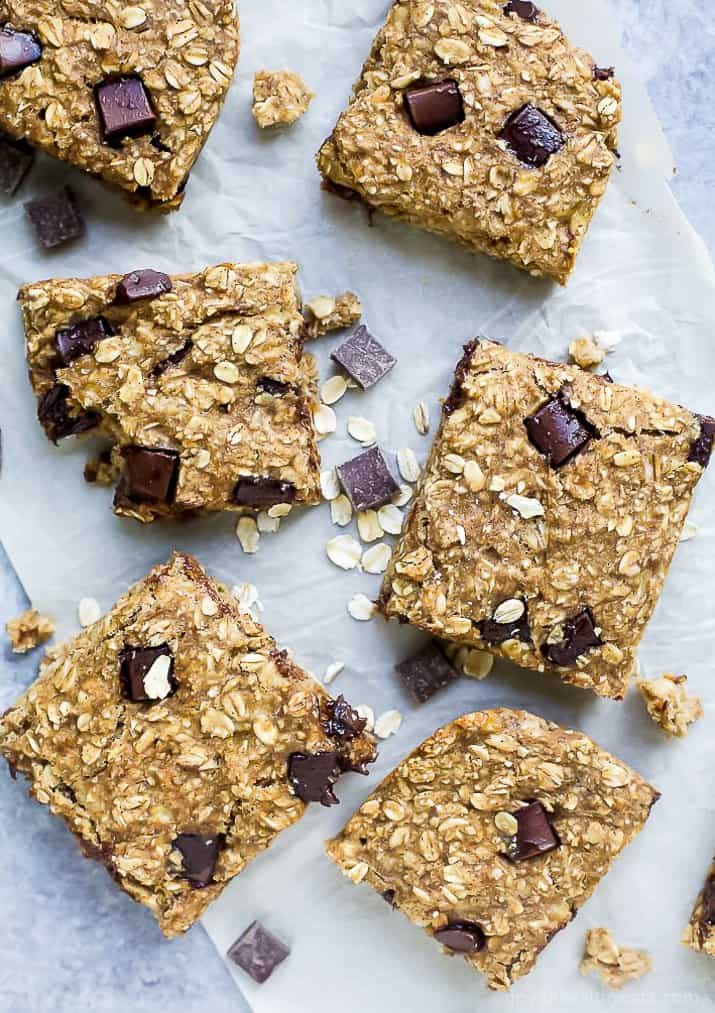 baked oatmeal bars lined up on parchment paper