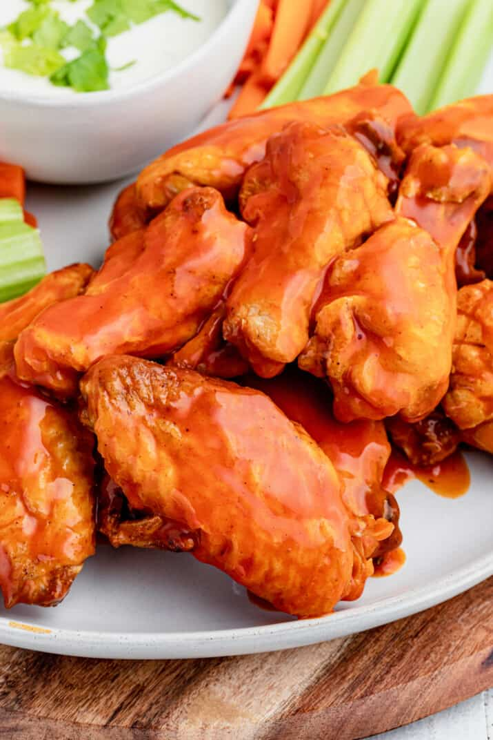 A Close-Up Shot of Spicy Baked Wings on a White Plate