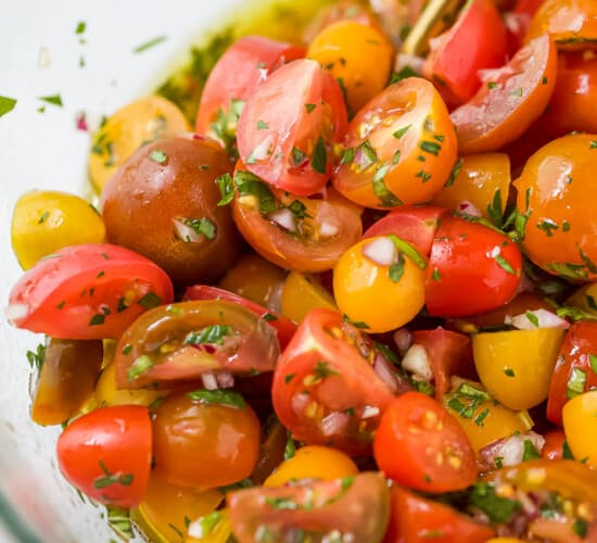 close up of marinated tomato salad in a bowl