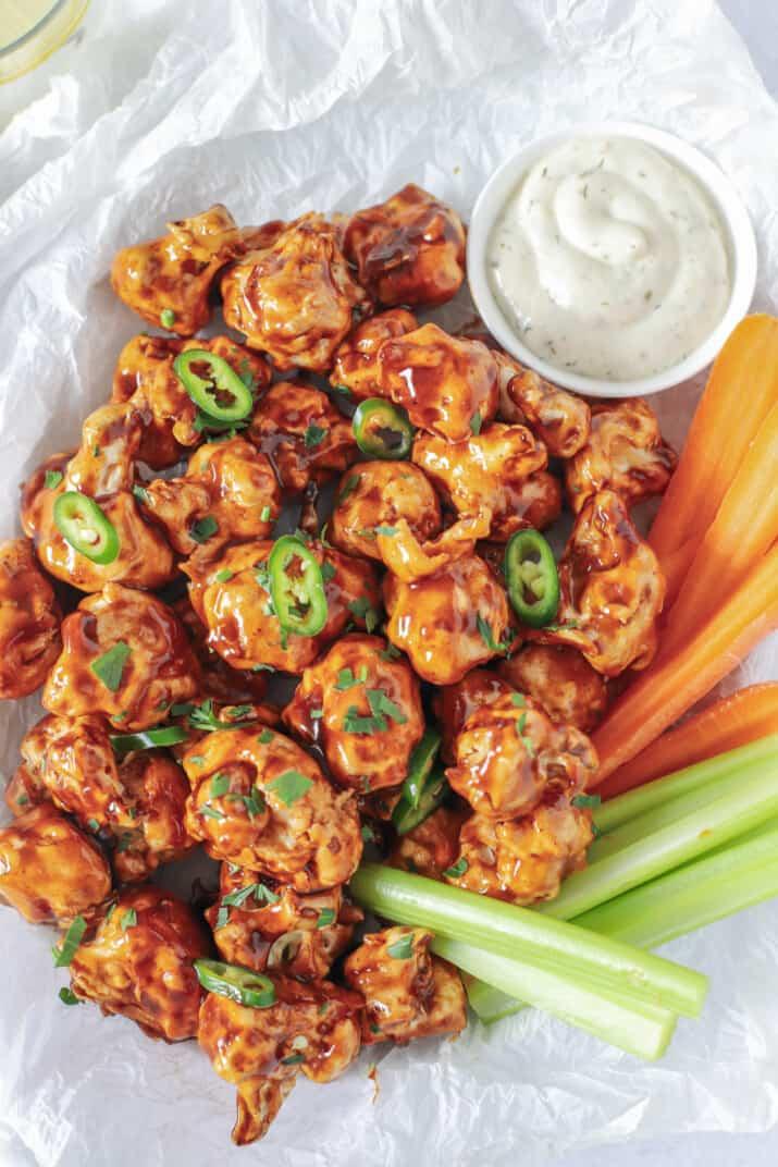 air fryer honey bbq cauliflower wings in a basket with veggies