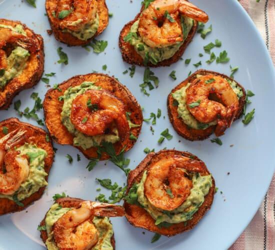 Seven shrimp appetizer bites arranged neatly on a baby blue plate