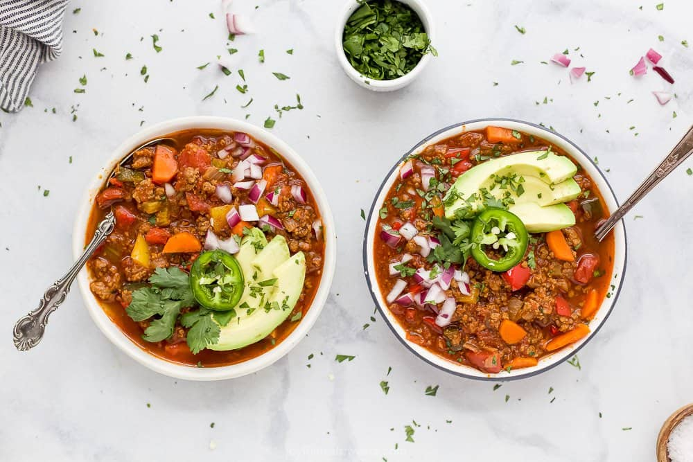 bowl of whole30 beef chili with toppings
