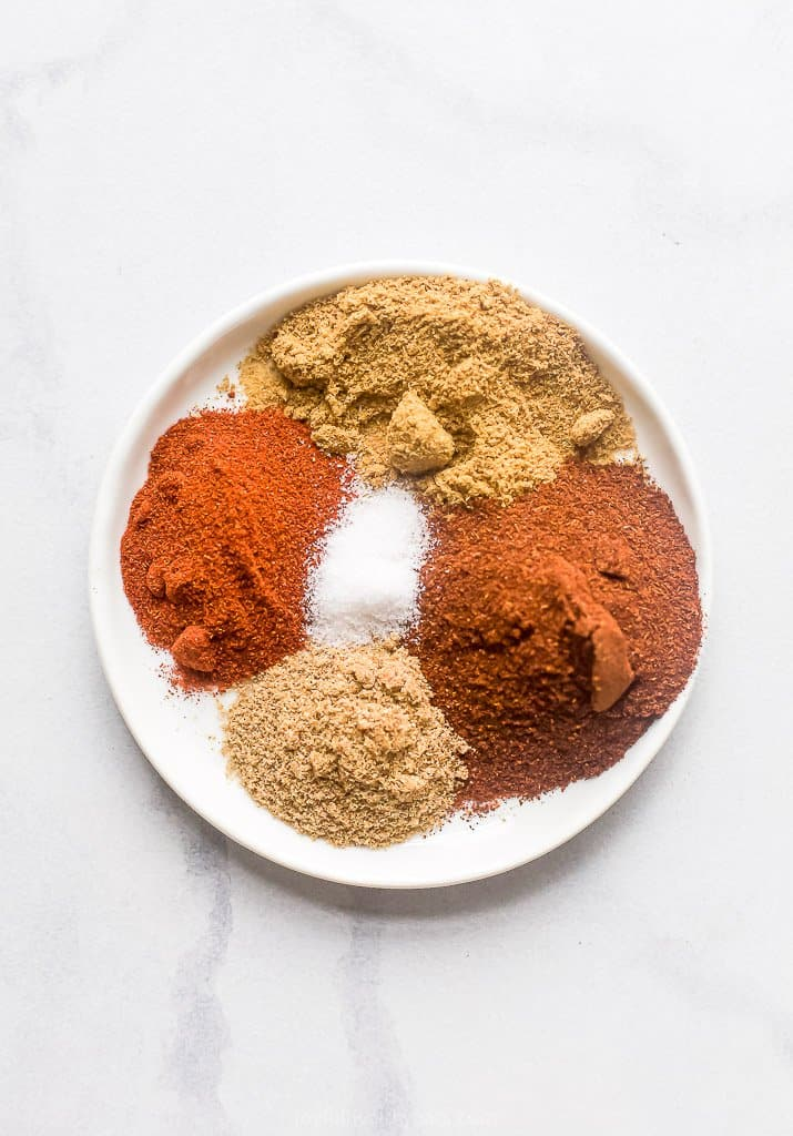 spices on a plate for beef chili